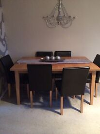 Extendable dinning table and faux leather chairs