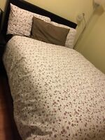 A double bed for sale with a mattress