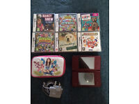 Nintendo DSi XL with games and case