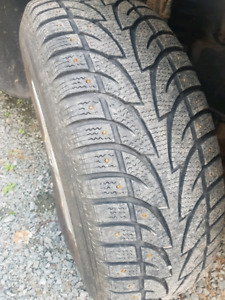 4 Winter studded tires and rims