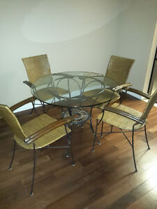 Wicker dinette with glass table top.