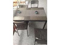 Black wooden table ~ Complete with x4 black metal chairs, including detachable cushion covers