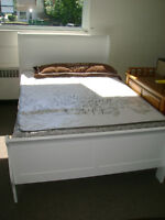 New white sleigh bed, Head board foot board and rails. $399.