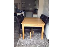 Oak extending table an 4 brown faux leather high back chairs