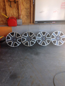 4 brand new Ford rims