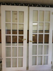 Excellent condition Solid white French doors with beveled glass
