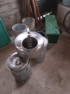 Surge milker and cans