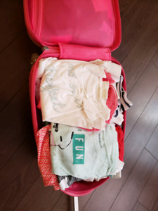 1 girls luggage full of clothes and more..