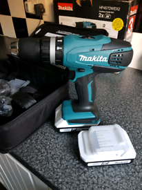 Makita hammer drill with two 1.5ah lithium batteries