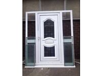 White pvc front door with glazed side panels
