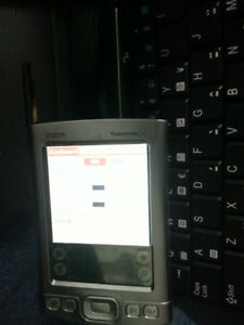 Palm Tungsten E2 with keyboard and documentation