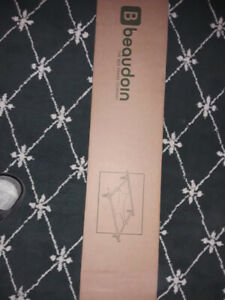 Black Queen sized bed frame still in box ($70)