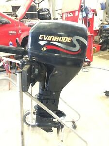 Reduced!! Want it gone!4-stroke 9.9 Evinrude LOW HOURS!!!