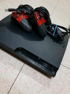 Playstation 3 with 2 controllers for sale.