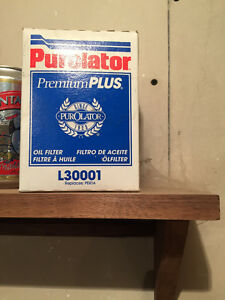 Chevy hubcap & Purolator oil filter box