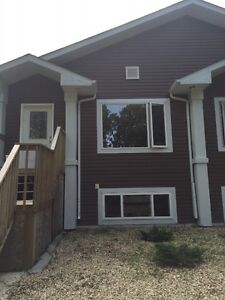 REDWATER  5 BEDROOM CLEAR NEWER HOME WITH GARAGE