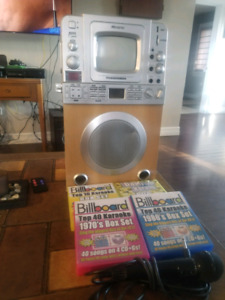 Karaoke Machine with microphone and Cd's for sale