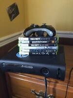 Xbox 360 w/ Wireless controller and Network Adapter and Games
