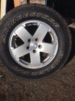 5 Bridgetone tires and rims 255/70/18-good condition