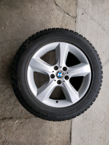 """OEM BMW 18"""" rims (all 4) with winter tires."""