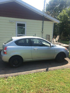 2010 Hyundai Accent Grey Coupe (2 door)