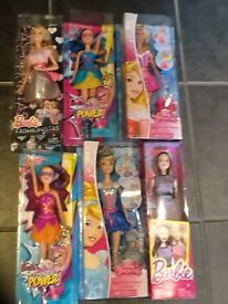 GIRLS BARBIES NEW AND SEALED