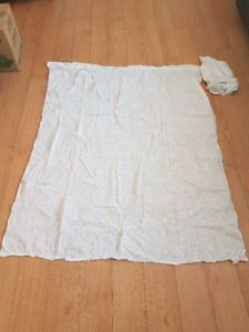 Two panels of beige cotton curtains with white floral pattern
