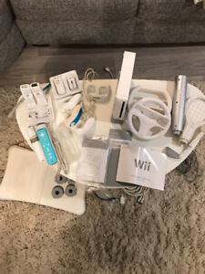 Wii console, 3 controller, fit board, games, etc.