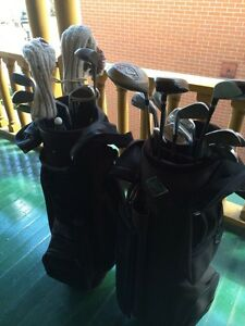 Two sets of golf clubs. Left and Right handed