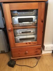Pine glass fronted stereo cabinet with drawer