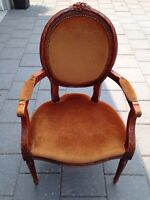Antique oversized wood chair with arm rests