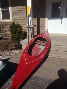 Large Kayak with paddle $350.
