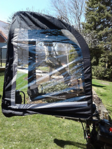 Snow blower wind protector
