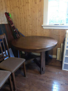 Riverbend Dining table with built in butterfly leaf and 4 chairs