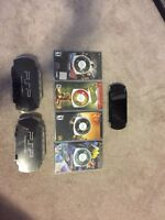 PSP 3000, 2 cases, 5 games, a charger and 2 memory cards