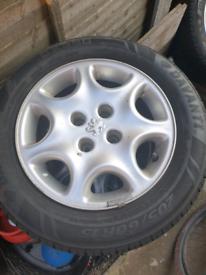 4 x alloys w/tyres + 1 x steel rim w/new Michelin tyre (fit Peugeot)