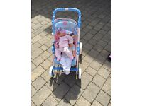 Kids pram with dolls included