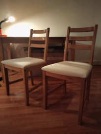 Ikea wooden table and two wooden chairs