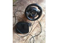 PlayStation 2 steering wheel with pedals