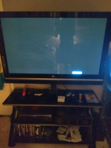 "54"" TV and black glass stand"