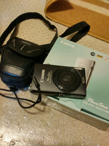 Canon powershot elph 320 hs with bag