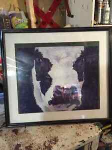 large framed cow painting covered in glass