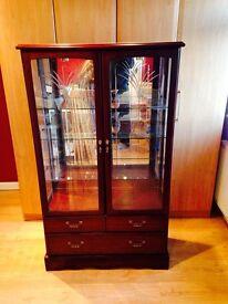 Mahogany glass cabinet.