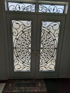 Full length wrought iron double door inserts starting at $700