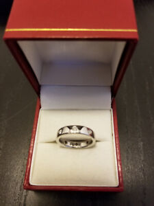 Solid Platinum Wedding Band with Diamonds, appraised at $2200