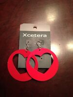 Xcetera earrings and nail appliqué