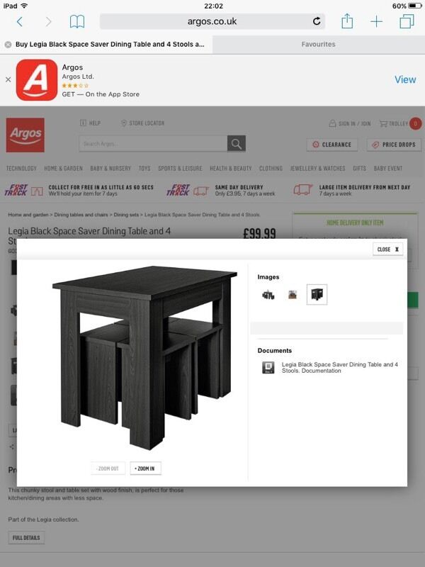 Black space saving dining table   chairs still selling in Argos
