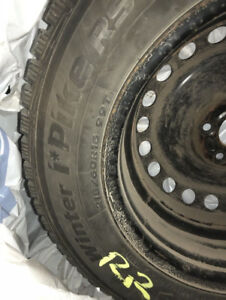 """16"""" Ford Fusion winter tires with rims"""