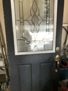 Used Steel front door with beautiful inlay glass window