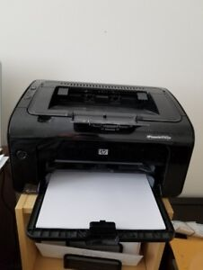 HP LaserJet P1102W in good condition with new cartridge.